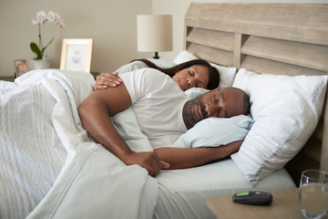 Couple sleeping in bed